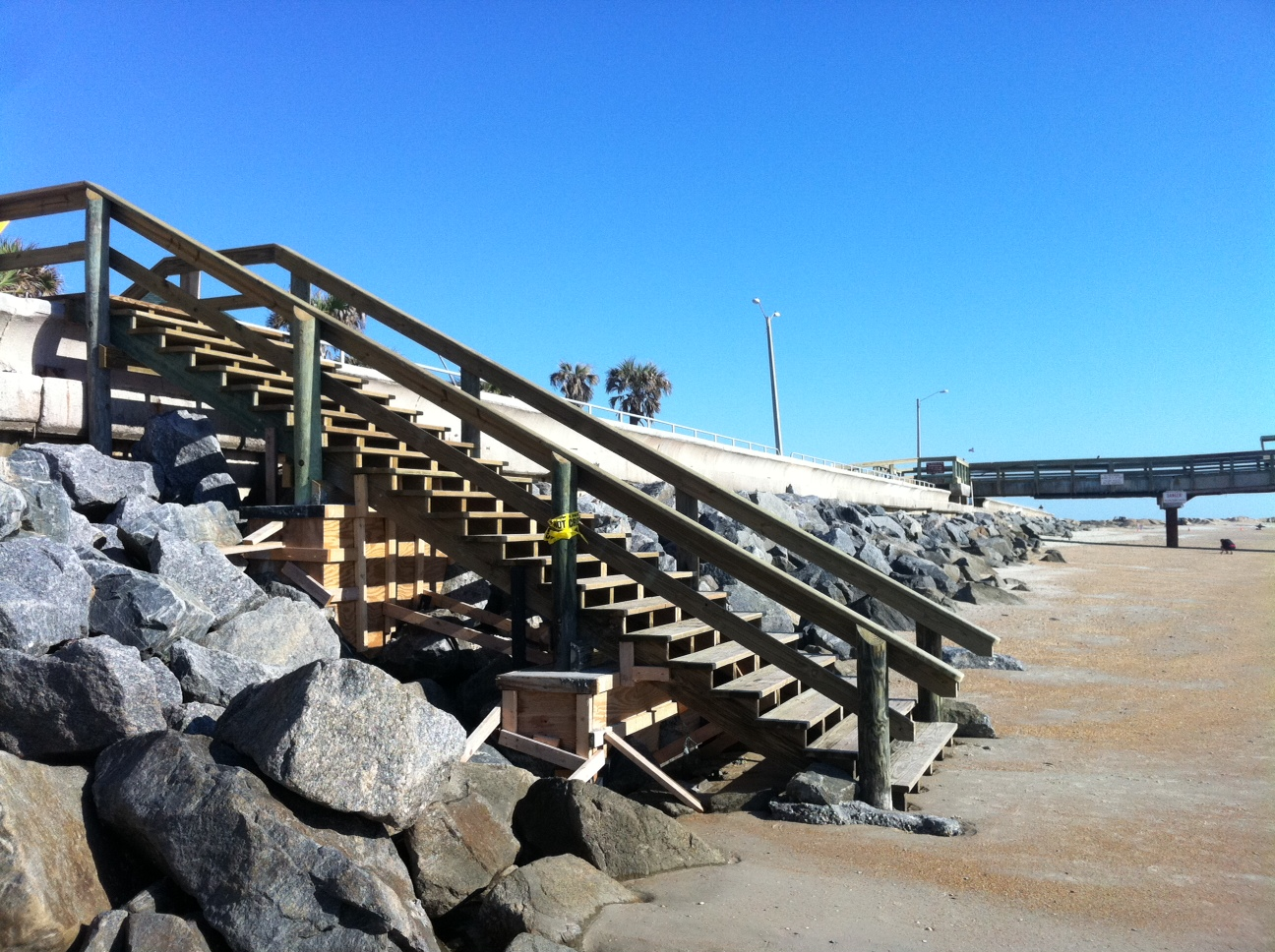 Lovely Side View Of Stairs With Pier In The Background