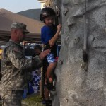 Climbing the rock wall with the National Guard